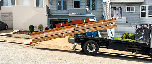 Curbside lumber delivery in Oakland, CA.